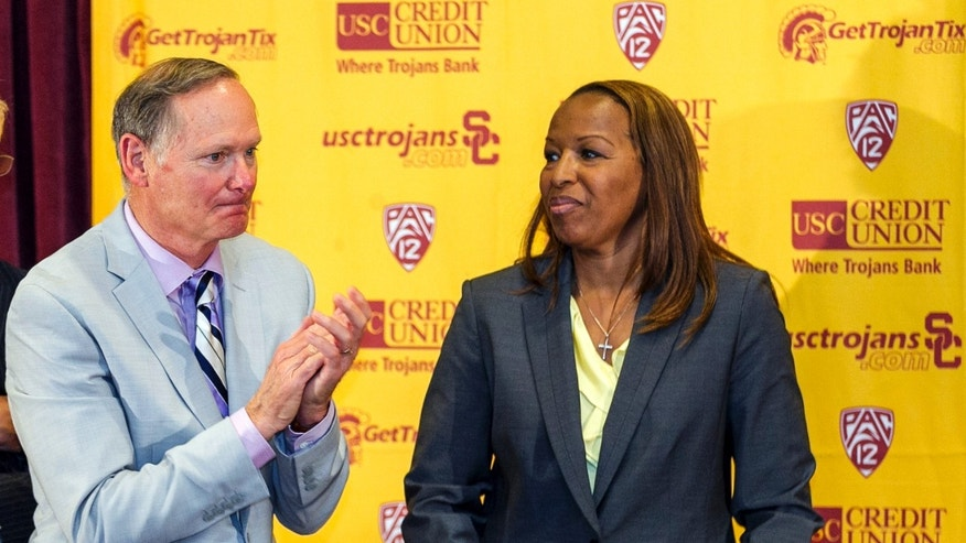 Southern California athletic director Pat Haden, left, introduces new head coach Cynthia Cooper-Dyke during an NCAA college basketball news conference, Tuesday, April 16, 2013, in Los Angeles. Cooper-Dyke replaces Michael Cooper, who quit last month after four seasons. (AP Photo/Damian Dovarganes)