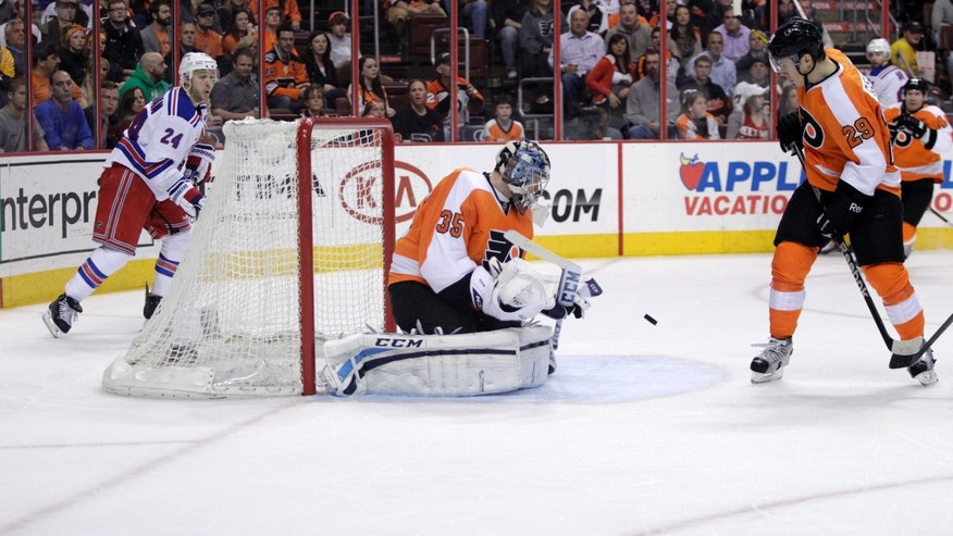 Philadelphia Flyers goalie Steve Mason (35) makes a save against the  New York Rangers in the first period of an NHL hockey game, Tuesday, April 16, 2013 in Philadelphia. (AP Photo/ H. Rumph Jr)