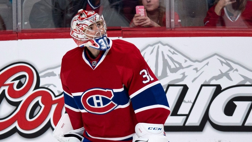 Montreal Canadiens goaltender looks up at the replay following a goal by Philadelphia Flyers' Claude Giroux during the second period of an NHL hockey game on Monday, April 15, 2013 in Montreal. (AP Photo/The Canadian Press, Paul Chiasson)