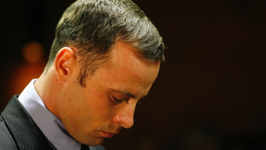 Feb. 21, 2013: In this file photo, Olympic athlete Oscar Pistorius stands during his bail hearing at the magistrate court in Pretoria, South Africa.