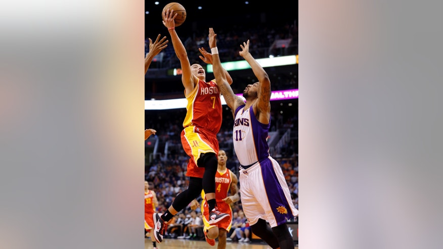 Houston Rockets' Jeremy Lin (7) drives past Phoenix Suns' Markieff Morris (11) during the first half of an NBA basketball game, Monday, April 15, 2013, in Phoenix. (AP Photo/Matt York)
