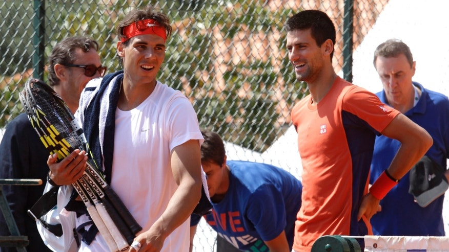 Novak Djokovic of Serbia, right, and Spain's Rafael Nadal are seen during a practice session at the Monte Carlo Tennis Masters tournament in Monaco, Tuesday, April 16, 2013. (AP Photo/Lionel Cironneau)