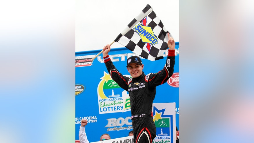 Kyle Larson celebrates in Victory Lane after winning the NASCAR Camping World Truck Series auto race in Rockingham, N.C., Sunday, April 14, 2013. (AP Photo/Jim R. Bounds)