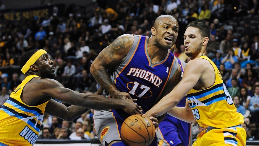 Denver Nuggets guard Ty Lawson, left, and Nuggets guard Evan Fournier, right, of France, strip the ball from Phoenix Suns guard P.J. Tucker, center, in the first quarter of an NBA basketball game on Wednesday, April 17, 2013, in Denver. (AP Photo/Chris Schneider)