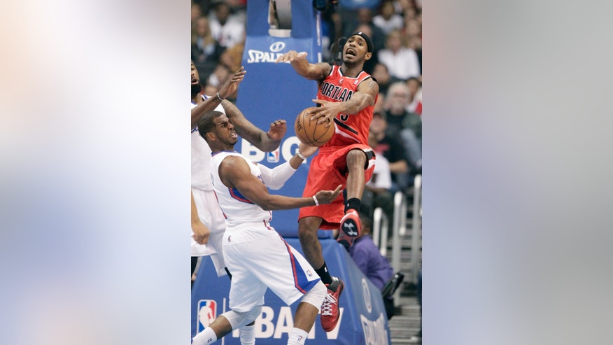 Portland Trail Blazers guard Will Barton (5) and Los Angeles Clippers guard Chris Paul (3) battle for a rebound in the first half of an NBA basketball game in Los Angeles Tuesday, April 16, 2013. (AP Photo/Reed Saxon)
