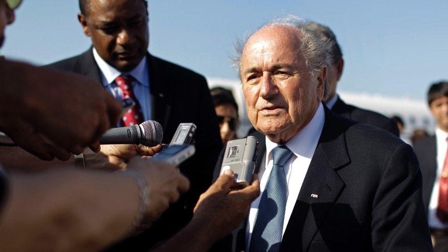 FIFA President Joseph Sepp Blatter speaks to reporters at the Jose Marti airport upon arrival to Havana, Cuba, Tuesday, April 16, 2013. Blatter is visiting Cuba for two days and then travels to Panama. (AP Photo/Franklin Reyes)
