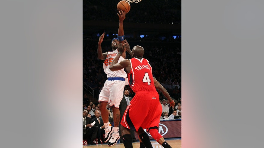 New York Knicks Quentin Richardson (55) shoots against Atlanta Hawks' Anthony Tolliver during the first half of an NBA basketball game, Wednesday, April 17, 2013, at Madison Square Garden in New York. (AP Photo/Mary Altaffer)