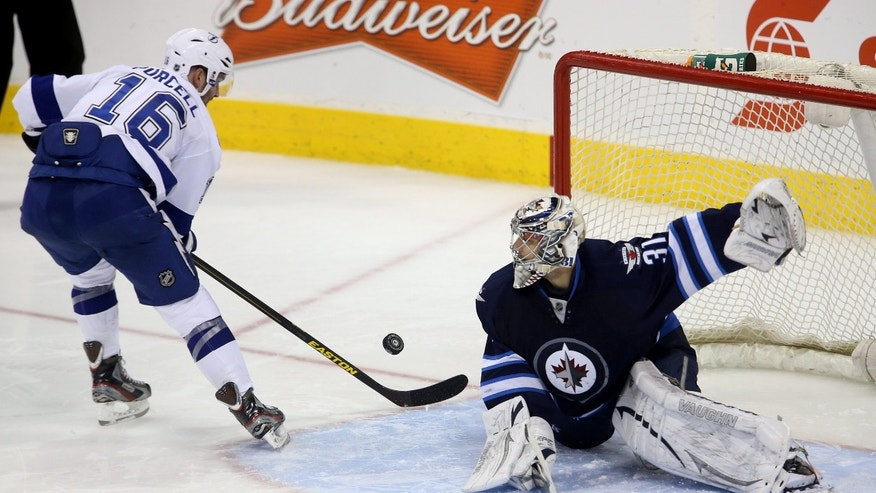 Tampa Bay Lightning's Teddy Purcell (16) is stopped during by Winnipeg Jets goaltender Ondrej Pavelec during the shootout of their NHL hockey game in Winnipeg, Manitoba, Tuesday, April 16, 2013. The Jets won 4-3. (AP Photo/The Canadian Press, Trevor Hagan)