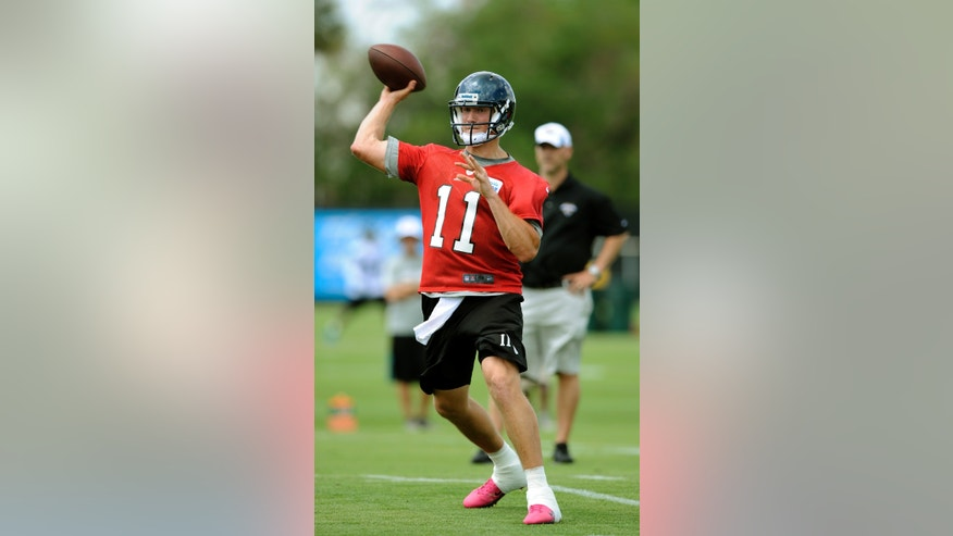 Jacksonville Jaguars quarterback Blaine Gabbert (11) passes the ball during a voluntary veteran NFL football mini-camp,  Tuesday, April 16, 2013, in Jacksonville, Fla. (AP Photo/Stephen Morton)