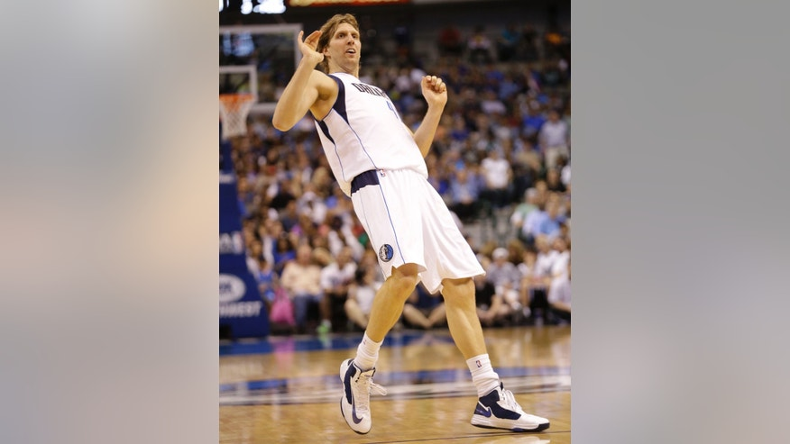 Dallas Mavericks forward Dirk Nowitzki (41), of Germany, looks awkward after a shot during the second half of an NBA basketball game against the New Orleans Hornets in Dallas, Wednesday, April 17, 2013. Dallas won 99-87. (AP Photo/Mike Fuentes)
