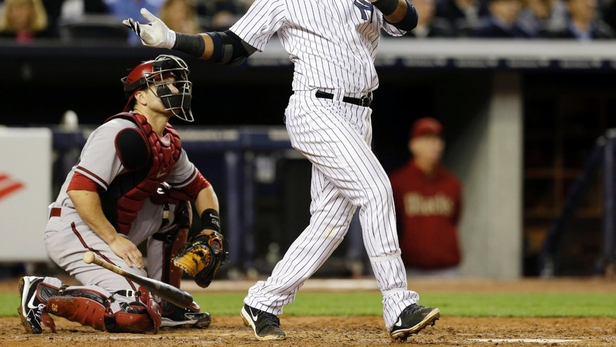 New York Yankees' Robinson Cano watches his fourth-inning, three-run home run off Arizona Diamondbacks starting pitcher Brandon McCarthy in a baseball game at Yankee Stadium in New York, Tuesday, April 16, 2013. Arizona catcher Miguel Montero, left, watches from behind the plate. (AP Photo/Kathy Willens)