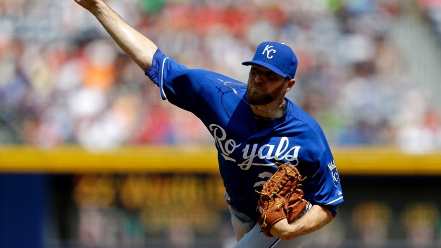 Kansas City Royals starting pitcher Wade Davis throws in the first inning of a baseball game against the Atlanta Braves, Wednesday, April 17, 2013, in Atlanta. (AP Photo/David Goldman)