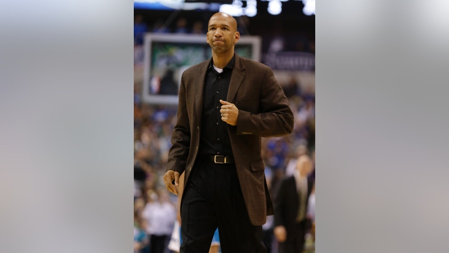 New Orleans Hornets head coach Monty Williams reacts during the second half of an NBA basketball game against the Dallas Mavericks in Dallas, Wednesday April 17, 2013. Dallas won 99-87. (AP Photo/Mike Fuentes)