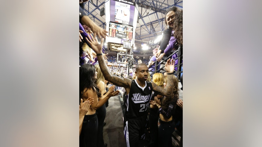 Sacramento Kings guard Isaiah Thomas thanks the fans as he leaves the court after the Kings 112-108 loss to the Los Angeles Clippers  in an NBA basketball game in Sacramento, Calif., Wednesday,  April 17, 2013. With the pending sale of the team and possible move to Seattle, Wednesday's game might be the last in Sacramento.(AP Photo/Rich Pedroncelli)