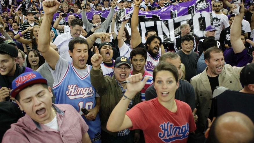Sacramento Kings fans rally in support for the team to remain in Sacramento after their game against the Los Angeles Clippers in Sacramento, Calif., on April 17, 2013.(AP Photo/Steve Yeater)