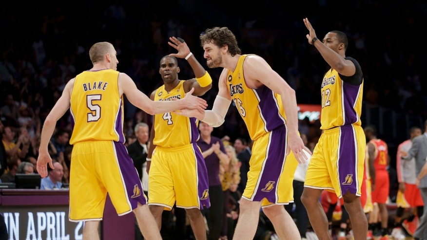 Los Angeles Lakers' Steve Blake(5) is greeted by Pau Gasol(16), of Spain, Antawn Jamison(4) and Dwight Howard(12) after making a three-point basket against the Houston Rockets during the second of an NBA basketball game in Los Angeles, Wednesday, April 17, 2013. The Lakers won 99-95 in overtime. (AP Photo/Jae C. Hong)