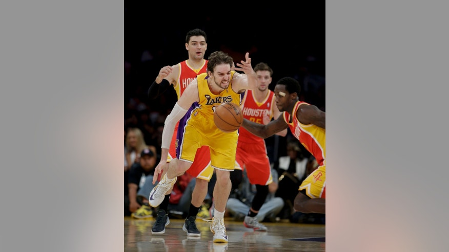 Houston Rockets' Patrick Beverley, right, steals the ball from Los Angeles Lakers' Pau Gasol, of Spain, during the second of an NBA basketball game in Los Angeles, Wednesday, April 17, 2013. The Lakers won 99-95 in overtime. (AP Photo/Jae C. Hong)