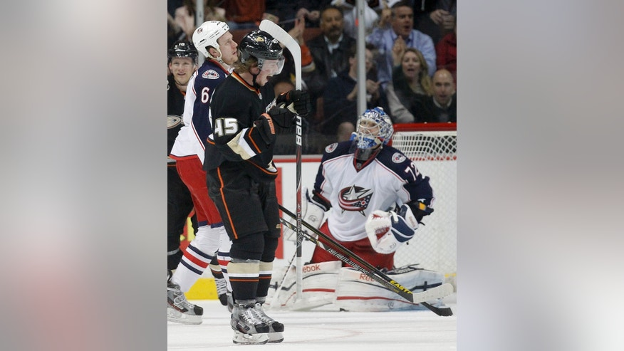 Anaheim Ducks defenseman Sami Vatanen, left, celebrates a goal by Sheldon Souray past Columbus Blue Jackets goalie Sergei Bobrovsky during the first period of an NHL hockey game in Anaheim, Calif., Wednesday, April 17, 2013. (AP Photo/Chris Carlson)
