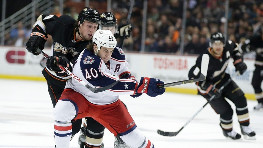 Columbus Blue Jackets right wing Jared Boll (40) skates past Anaheim Ducks left wing Matt Beleskey during the second period of an NHL hockey game in Anaheim, Calif., Wednesday, April 17, 2013. (AP Photo/Chris Carlson)