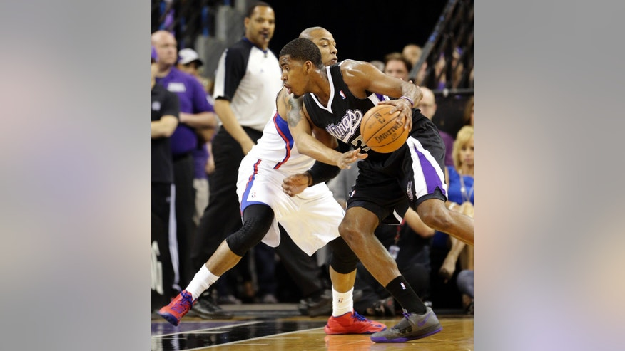 Sacramento Kings forward Jason Thompson, right, drives against Los Angeles Clippers forward Caron Butler during the first quarter of an NBA basketball game in Sacramento, Calif., Wednesday, April 17, 2013. (AP Photo/Rich Pedroncelli)