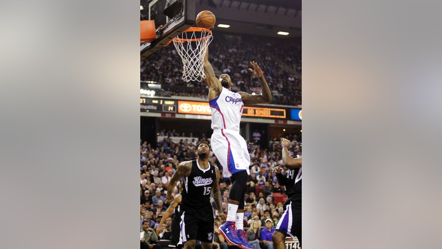 Los Angeles Clippers center DeAndre Jordan, right, goes to the basket over Sacramento Kings center DeMarcus Cousins, left, during the first quarter of an NBA basketball in Sacramento, Calif., Wednesday, April 17, 2013.(AP Photo/Rich Pedroncelli)