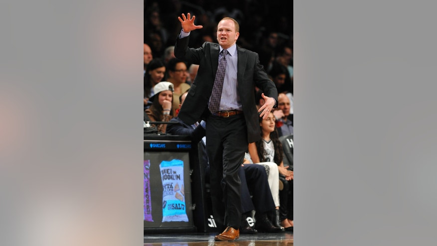 Detroit Pistons Head Coach Lawrence Frank directs his team crosscourt against the Brooklyn Nets in the first half of an NBA basketball game on Wednesday, April 17, 2013,at Barclays Center in New York. The Nets won 103-99. (AP Photo/Kathy Kmonicek)