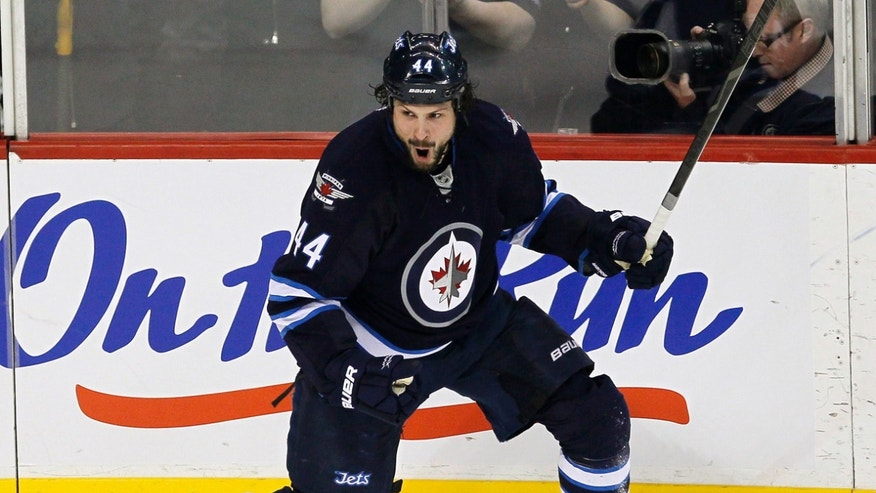Winnipeg Jets' Zach Bogosian (44) celebrates his goal against the Carolina Hurricanes during the first period of their NHL hockey game in Winnipeg, Manitoba, Thursday, April 18, 2013. (AP Photo/The Canadian Press, John Woods)