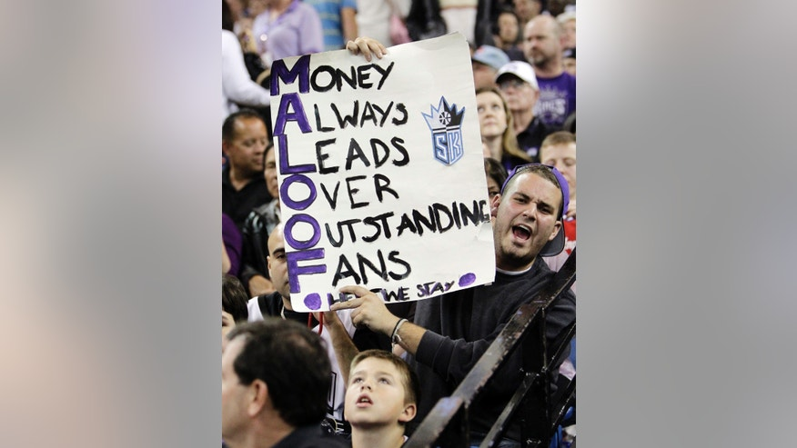 A Sacramento Kings fan holds a sign during an NBA basketball game against the Los Angeles Clippers in Sacramento, Calif., Wednesday, April 17, 2013. (AP Photo/Rich Pedroncelli)