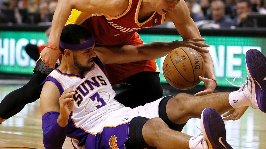 Houston Rockets' Jeremy Lin battles Phoenix Suns' Jared Dudley (3) for a loose ball during the first half of an NBA basketball game, Monday, April 15, 2013, in Phoenix. (AP Photo/Matt York)