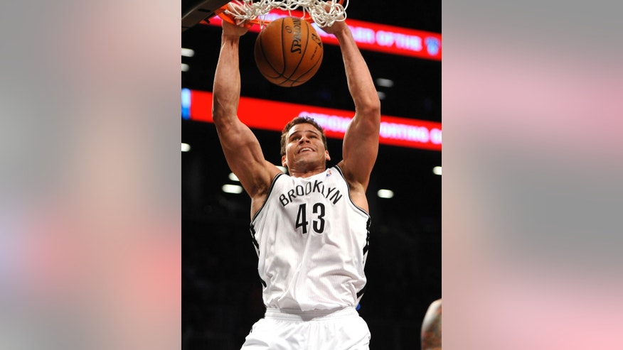 Brooklyn Nets' Kris Humphries (43) dunks against the Detroit Pistons in the first half of an NBA basketball game on Wednesday, April 17, 2013, at Barclays Center in New York. (AP Photo/Kathy Kmonicek)