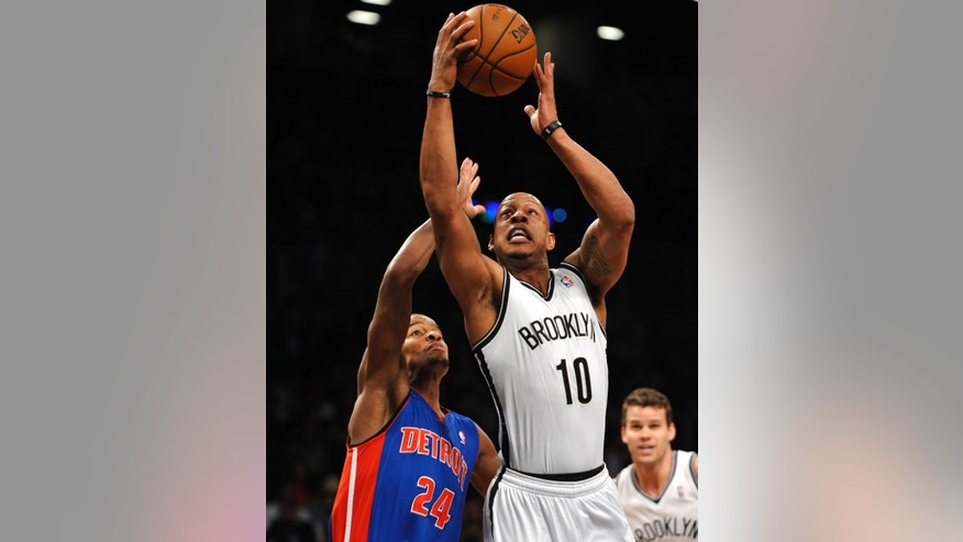 Brooklyn Nets' Keith Bogans (10) shoot over Detroit Pistons' Kim English (24) in the first half of an NBA basketball game on Wednesday, April 17, 2013, at Barclays Center in New York. (AP Photo/Kathy Kmonicek)