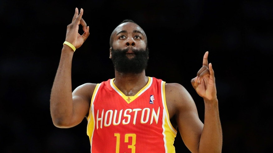 Houston Rockets' James Harden reacts after making a 3-pointer during the first half of an NBA basketball game against the Los Angeles Lakers in Los Angeles, Wednesday, April 17, 2013. (AP Photo/Jae C. Hong)