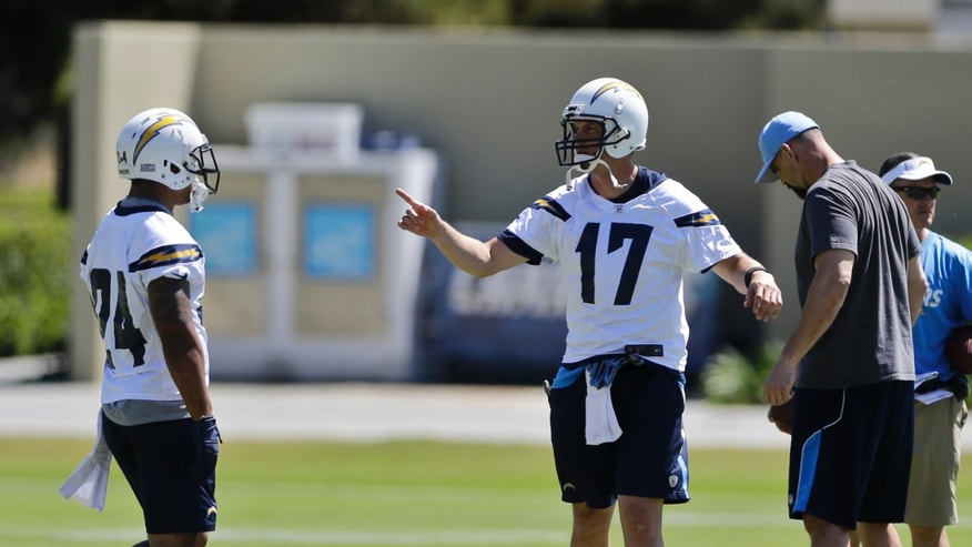 San Diego Chargers quarterback Philip Rivers (17) gives instructions to receivers during NFL football minicamp Thursday April 18, 2013 in San Diego. (AP Photo/Lenny Ignelzi)