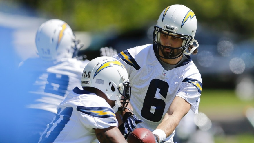 San Diego Chargers quarterback Charlie Whitehurst hands off during NFL football minicamp Thursday, April 18, 2013 in San Diego. (AP Photo/Lenny Ignelzi)