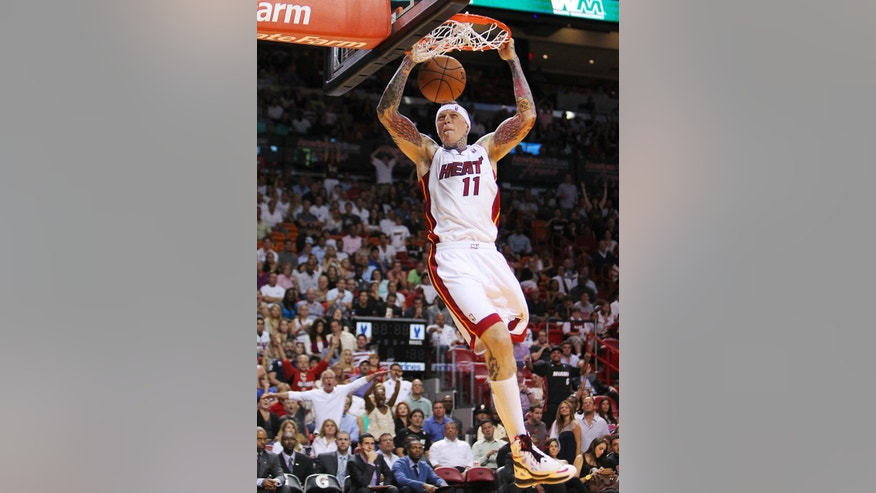 Miami Heat's Chris Andersen dunks against the Orlando Magic during the third quarter of their NBA basketball game, Wednesday, April 17, 2013, in Miami. The Heat won 105-93. (AP Photo/El Nuevo Herald, David Santiago)  MAGS OUT