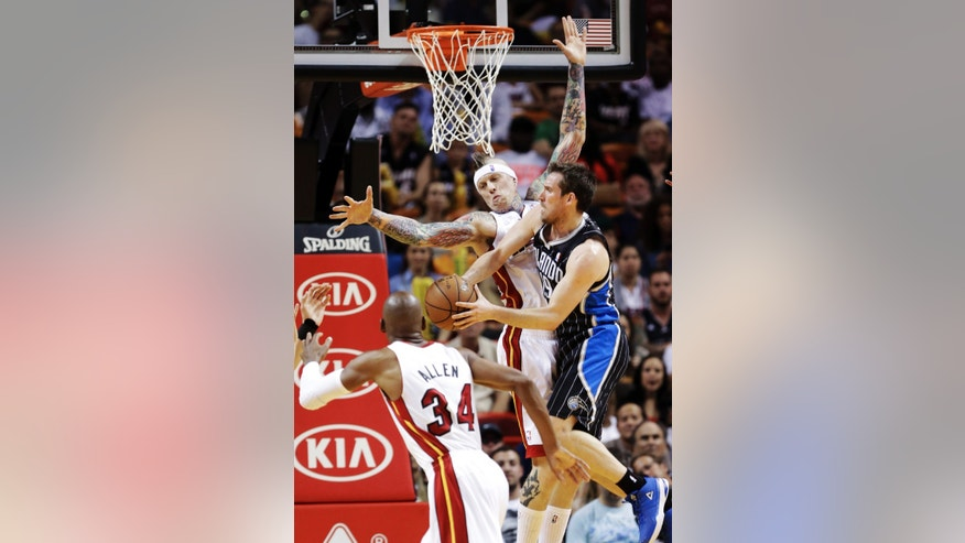 Orlando Magic guard Beno Udrih of Slovenia, right, shoots against Miami Heat guard Ray Allen (34) and forward Chris Andersen, center rear, during the first half of an NBA basketball game, Wednesday, April 17, 2013 in Miami. (AP Photo/Wilfredo Lee)