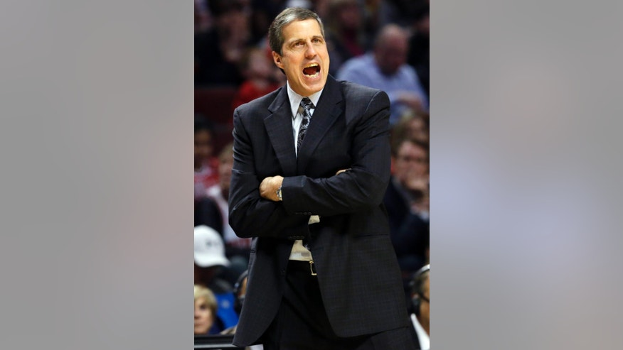Washington Wizards head coach Randy Wittman yells to his team during the first half of an NBA basketball game against the Chicago Bulls in Chicago, Wednesday, April 17, 2013. (AP Photo/Nam Y. Huh)
