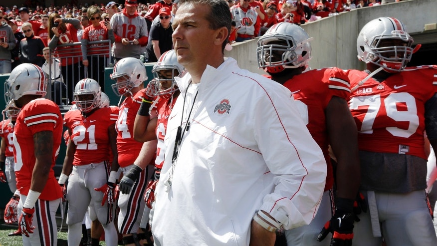 Ohio State head coach Urban Meyer waits to run onto the field with his team during their annual spring NCAA college football game, Saturday, April 13, 2013, in Cincinnati. (AP Photo/Al Behrman)