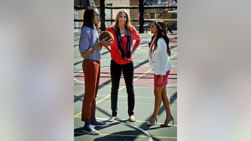In this April 17, 2013, photo, from left, Phoenix Mercury's Brittney Griner, Chicago Sky's Elena Delle Donne and Tulsa Shock's Skylar Diggins pose together following an interview with The Associated Press in New York. (AP Photo/Bebeto Matthews)