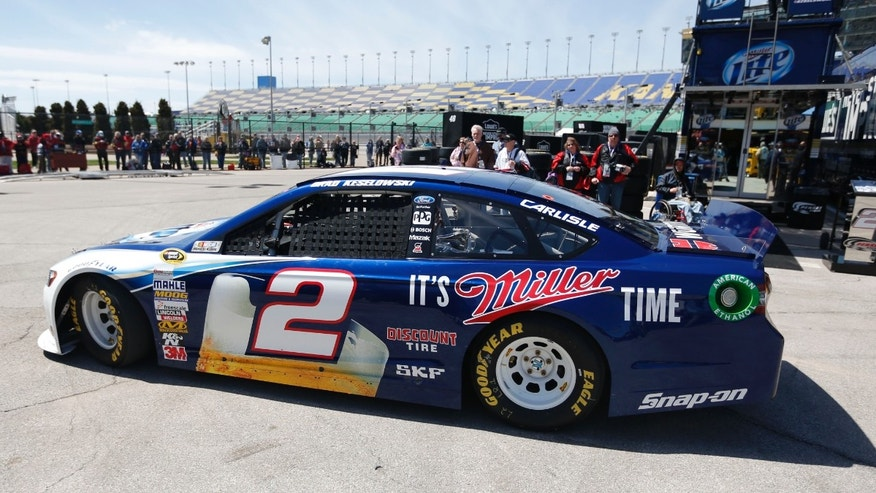 Driver Brad Keselowski pulls out of the garage for practice for Sunday's NASCAR Sprint Cup series auto race at Kansas Speedway in Kansas City, Kan., Friday, April 19, 2013. (AP Photo/Orlin Wagner)