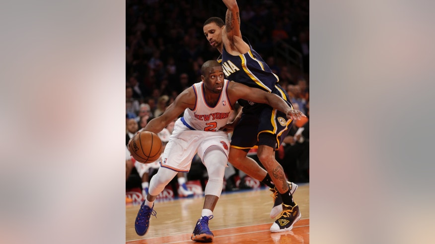 New York Knicks' Raymond Felton, left, drives past Indiana Pacers' George Hill during the second half of the NBA basketball game, Sunday, April 14, 2013, in New York. The Knicks won 90-80. (AP Photo/Seth Wenig)