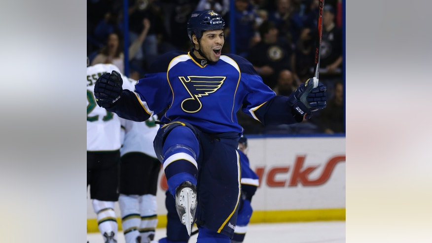 St. Louis Blues' Ryan Reaves celebrates after scoring during the second period of an NHL hockey game against the Dallas Stars, Friday, April 19, 2013, in St. Louis. (AP Photo/Jeff Roberson)