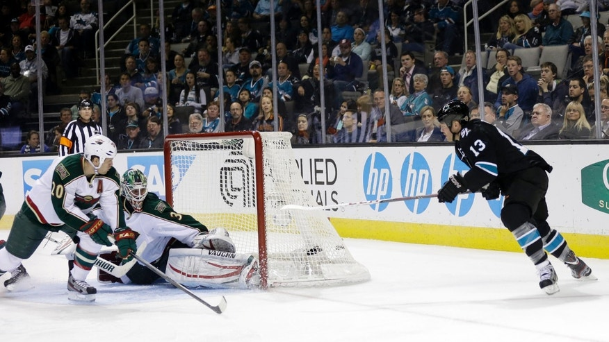 San Jose Sharks left wing Raffi Torres, right, scores past Minnesota Wild goalie Niklas Backstrom, of Finland, during the third period of an NHL hockey game in San Jose, Calif., Thursday, April 18, 2013. (AP Photo/Marcio Jose Sanchez)