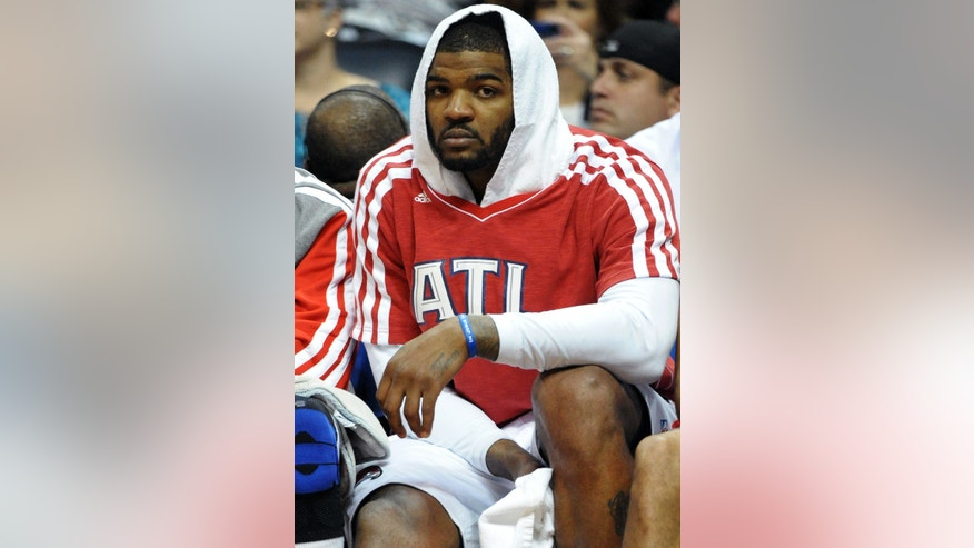 Atlanta Hawks forward Josh Smith watches from the bench in the second half of an NBA basketball game against the Toronto Raptors, Tuesday, April 16, 2013, at Philips Arena in Atlanta. Toronto won 113-96. (AP Photo/David Tulis)