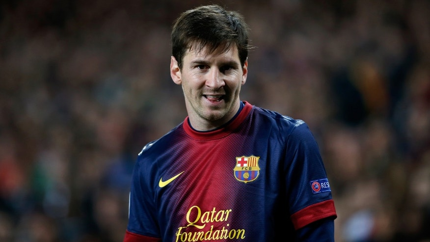 Barcelona's Lionel Messi, from Argentina, smiles during the Champions League quarterfinal second leg soccer match between FC Barcelona and Paris Saint-Germain FC at the Camp Nou stadium in Barcelona, Spain, Wednesday, April 10, 2013. (AP Photo/Emilio Morenatti)