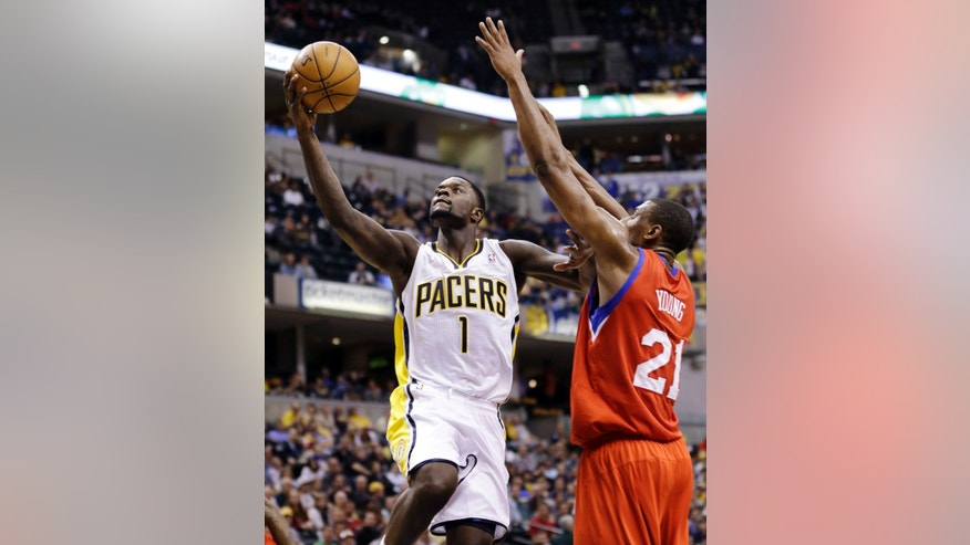 Indiana Pacers guard Lance Stephenson, left, shoots under Philadelphia 76ers forward Thaddeus Young in the second half of an NBA basketball game in Indianapolis, Wednesday, April 17, 2013. The 76ers won 105-95. (AP Photo/Michael Conroy)