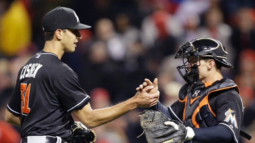 Miami Marlins relief pitcher Steve Cishek is congratulated by catcher Rob Brantly after they defeated the Cincinnati Reds 2-1 in a baseball game, Friday, April 19, 2013, in Cincinnati. (AP Photo/Al Behrman)
