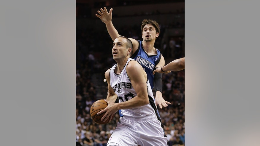 San Antonio Spurs' Manu Ginobili, left, of Argentina, drives past Minnesota Timberwolves' Alexey Shved, right, of Russia, during the first half of an NBA basketball game on Wednesday, April 17, 2013, in San Antonio. (AP Photo/Eric Gay)