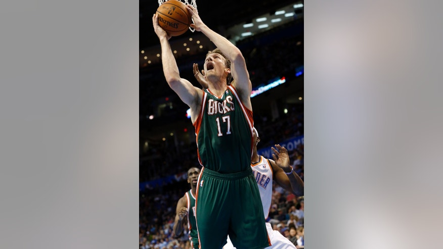 Milwaukee Bucks forward Mike Dunleavy (17) shoots in front of Oklahoma City Thunder forward Ronnie Brewer in the second quarter of an NBA basketball game in Oklahoma City, Wednesday, April 17, 2013. (AP Photo/Sue Ogrocki)