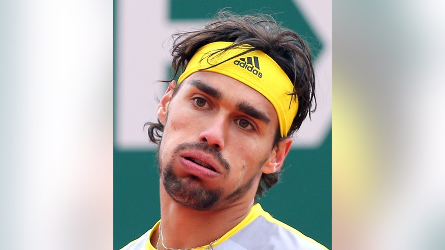 Fabio Fognini of Italy reacts during his semifinal match of the Monte Carlo Tennis Masters tournament in Monaco against Novak Djokovic of Serbia, Saturday, April 20, 2013. (AP Photo/Claude Paris)